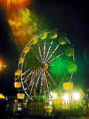 Exact positioning of camera under street lamp over ferris wheel.